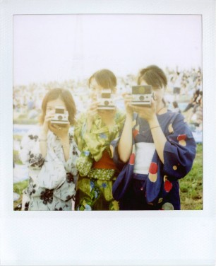 Japanese taking Polaroid pics