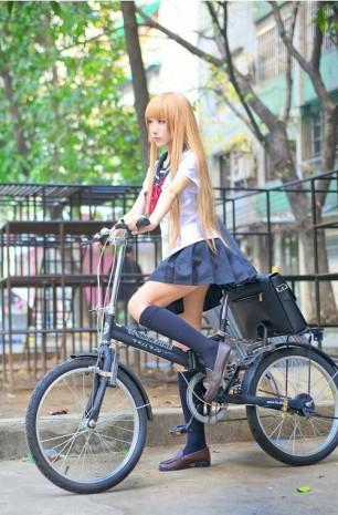 School Girl on Her Bike